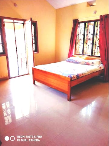 This is the first bedroom which comes with attached private bathroom and a balcony with beautiful view. The windows and doors come with magnetic Mosquito mesh so your stay is a comfortable and relaxed one ! Fresh and Clean bedsheets and Linens are provided!