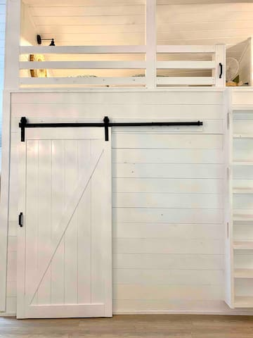Sliding barn door to master bedroom and loft for two shown above.