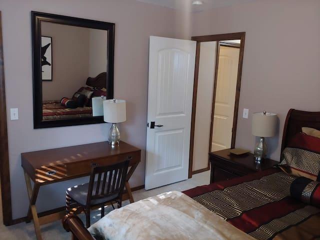 This is Bedroom 1 (Queen Bed and Desk)