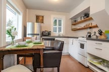 Petite but powerful this cottage has a full kitchen and dining area in Downtown Bend