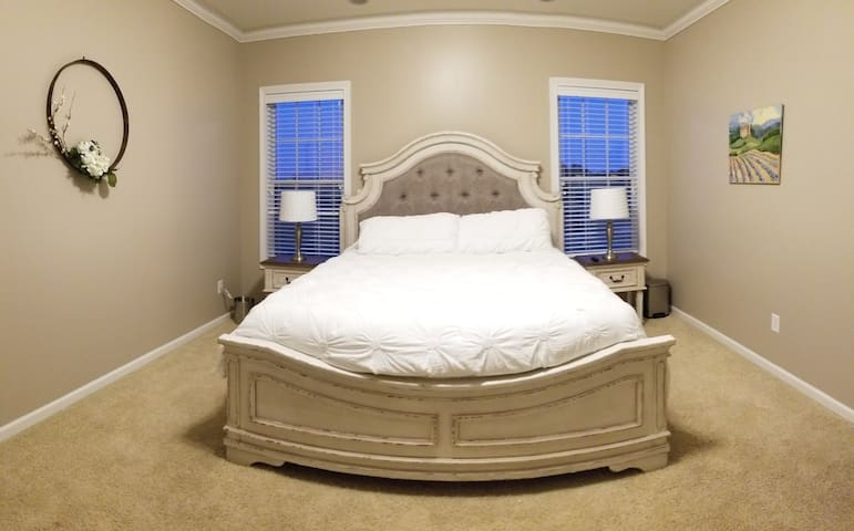 California king bed.  The windows overlook rolling hills behind the property.