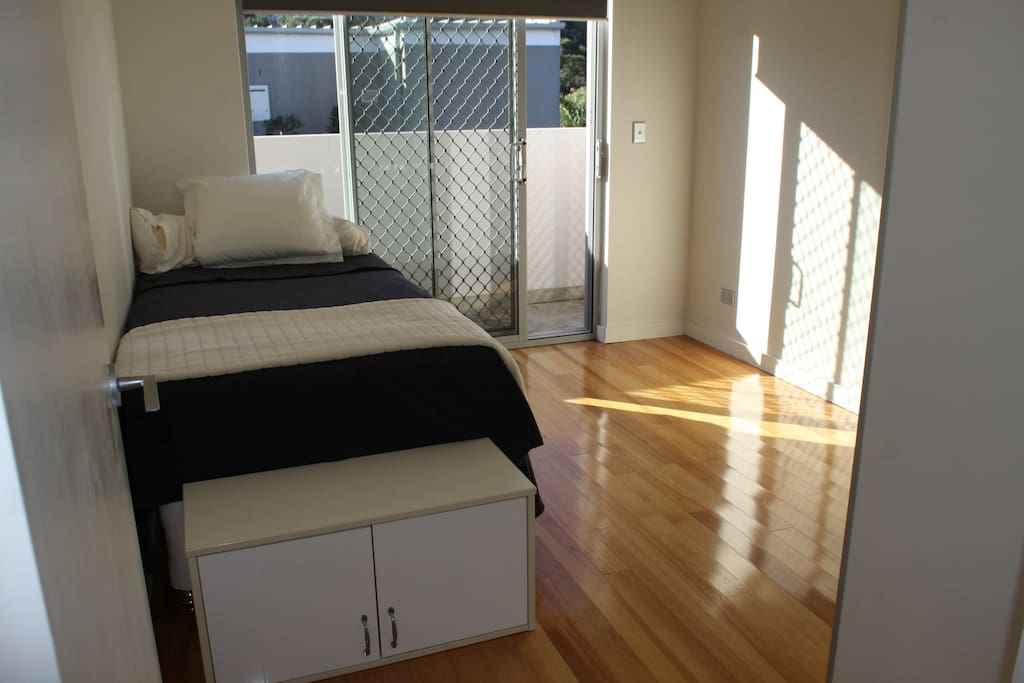 Spacious and sunny bedroom, with a king single bed (Sealy mattress)