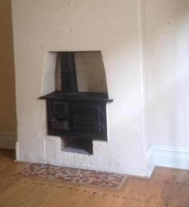 Working fireplace in room, however central heating keeps the house warm in winter