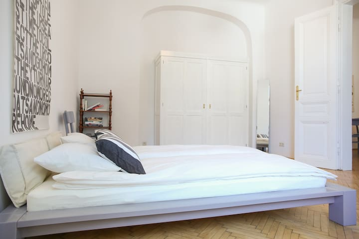 Large bedroom with cosy French bed