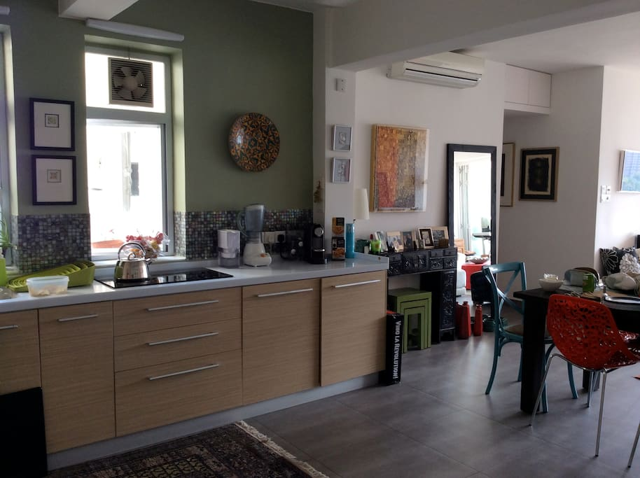 The view of the open-plan kitchen as you enter the apartment.