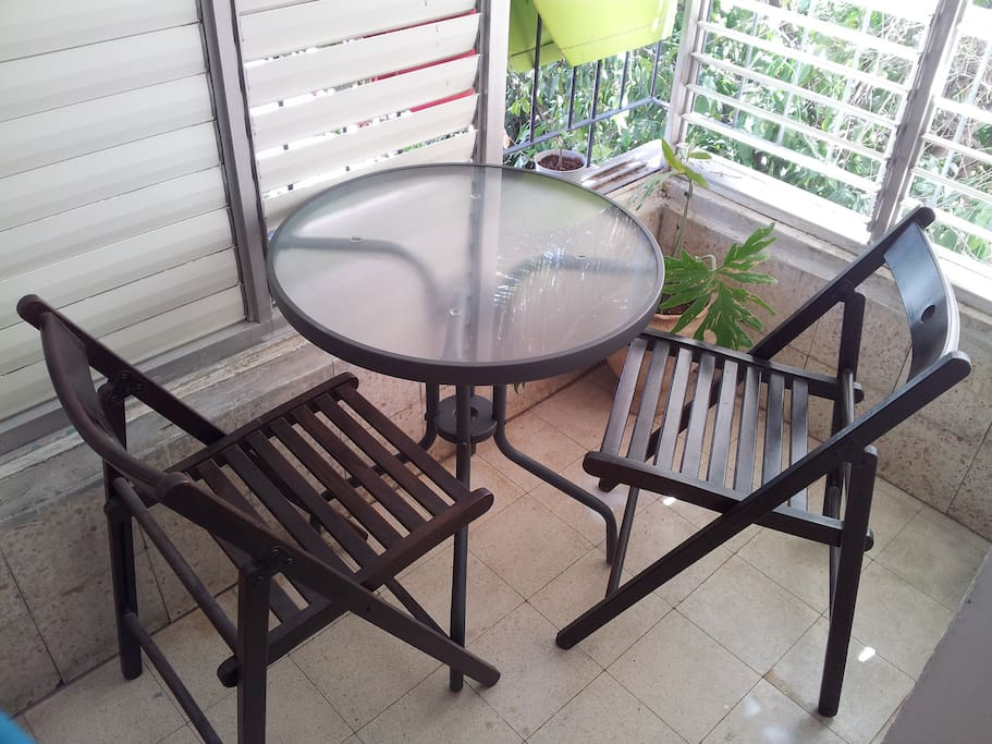 Your private balcony with a coffee table to enjoy your morning cofee and breakfast