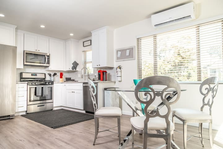 Open Kitchen With 4 Chair Dinning Table, Also Includes A/C and Heating Unit