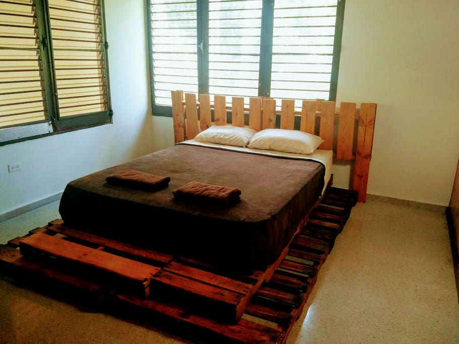 This bedroom has a queen bed and can host up to 3 guests with an additional double sized airbed on the floor. For groups of 4, please check out the other bedroom on the next photo.