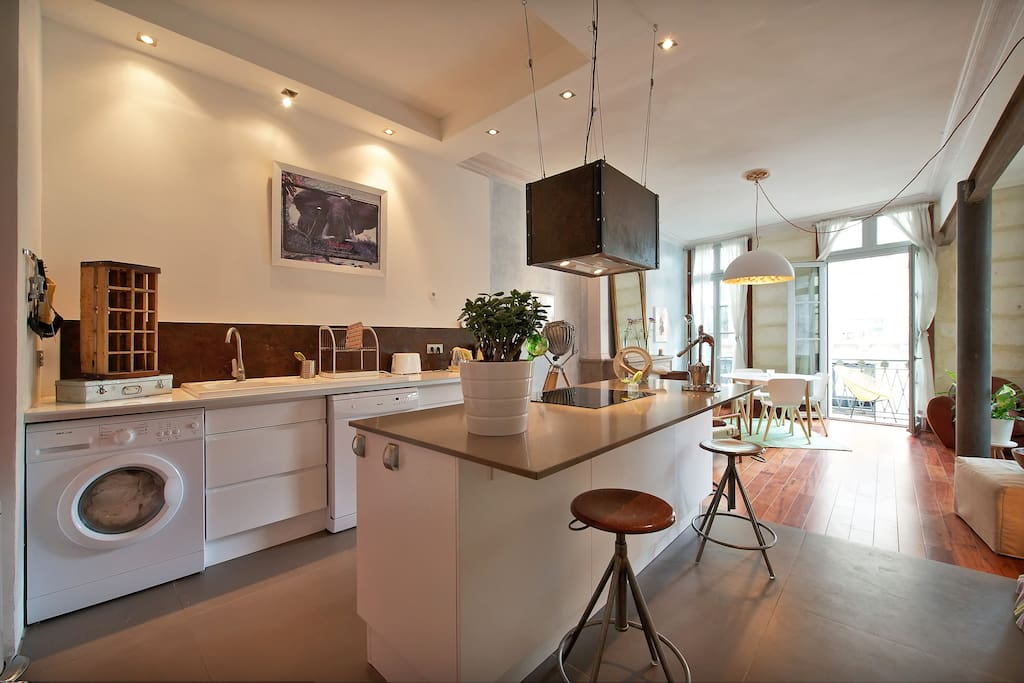 the modern kitchen and dining area