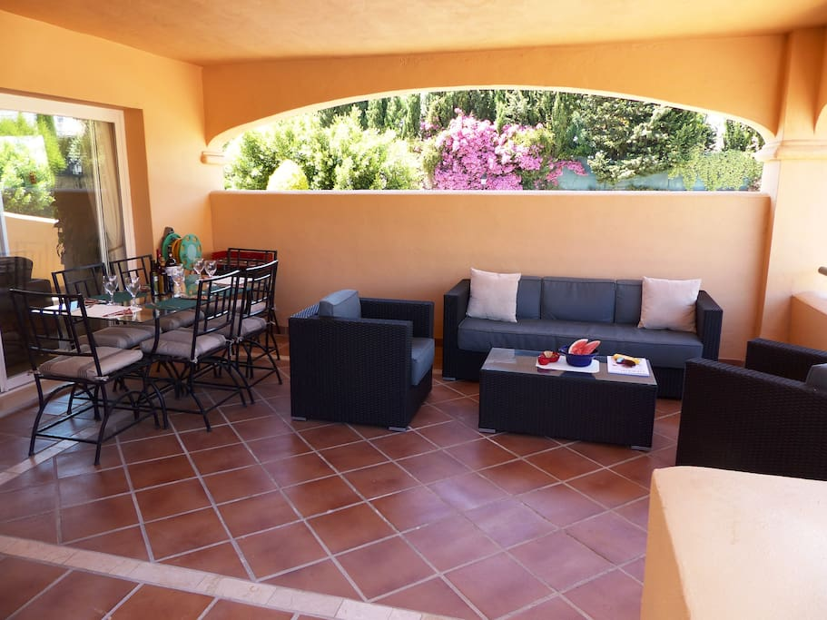 Terrace with outdoor dining area, BBQ and comfortable seating