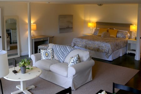 Sunrise Queen Suite offers a luxurious QUEEN bed, and loads of comforts and space to cocoon for a week with kitchenette with full fridge, sink, kettle , coffee machine microwave, dining, living and even work-space and double in wall USB chargers .