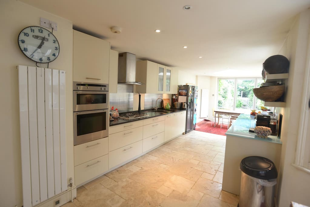 Fully equipped kitchen with double oven, hobs.