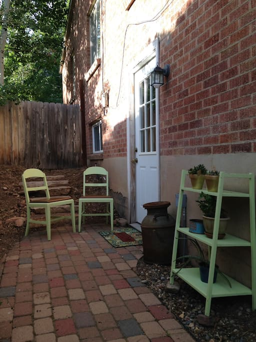 Private entrance to basement apartment where guestroom and amenities are located