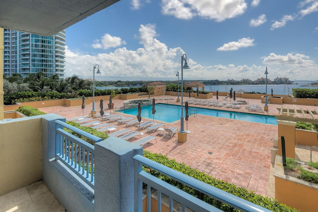 Condo pool, walking distance marina and beach. Stunning bay view and sunsets.