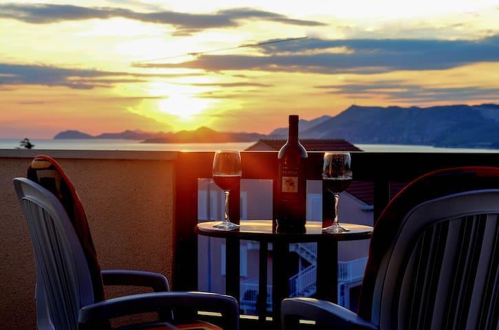 Romantic sunset vith glass of vine
