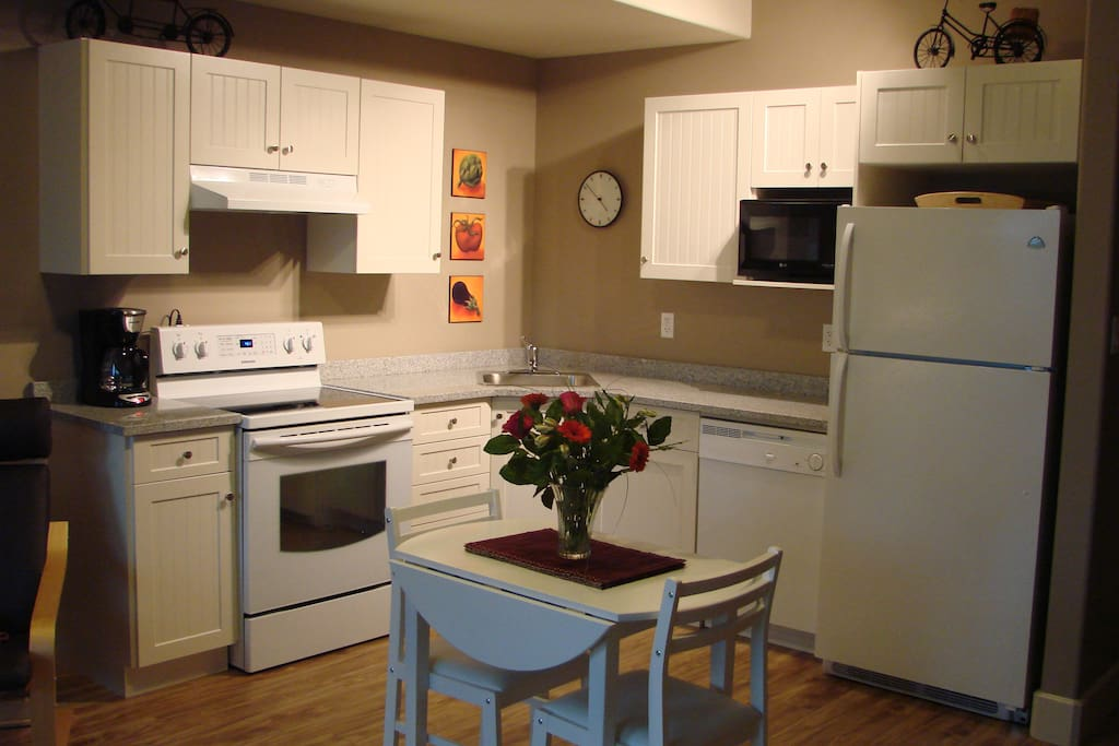 Fully equipped kitchen complete with dishwasher, full size refrigerator, stainless steel cookware, ceramic top stove and self cleaning oven.