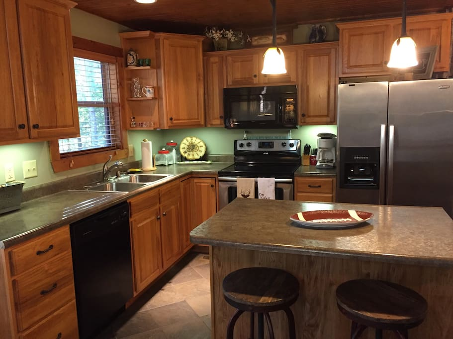 The kitchen has all updated appliances and about anything you might need to prepare a meal is in the cabinets.