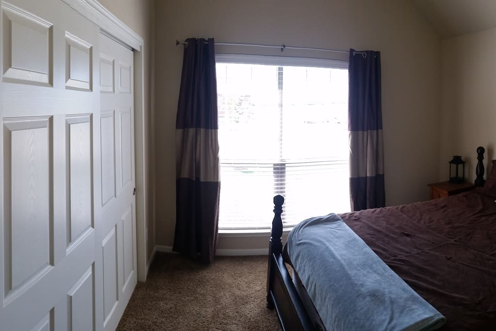 Your room, with a brand new queen bed, accessible closet, and 2 night stands