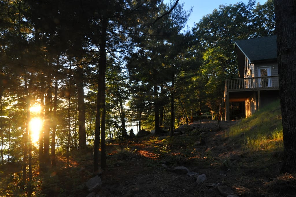 Sunset View of Chalet and proximity to lake, which is steps away from the house.