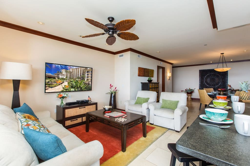 "New 60"" wall-mounted flat screen TV with BluRay DVD player and plenty of comfortable seating. Sleeper sofa allows Villa to comfortably accommodate up to six Guests."