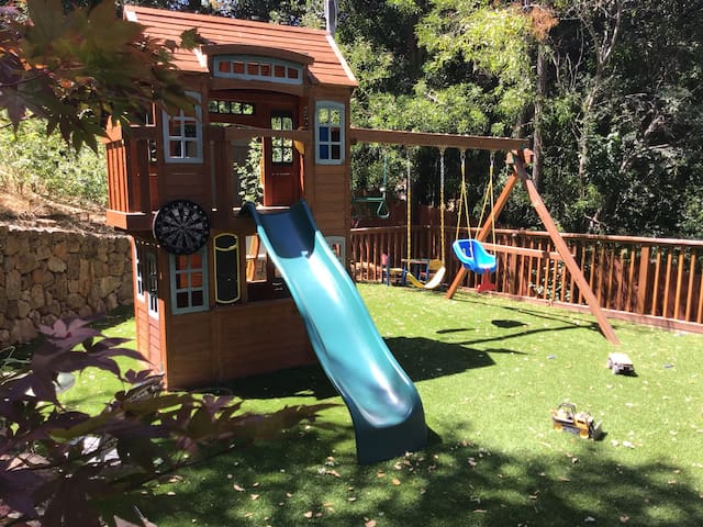 Wonderful outdoor oasis with a  beach style decorated interior family friendly home .