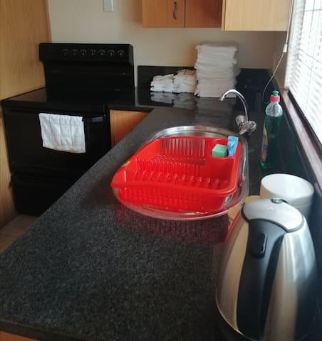 Self catering suite. Queen bed. Opt training room.