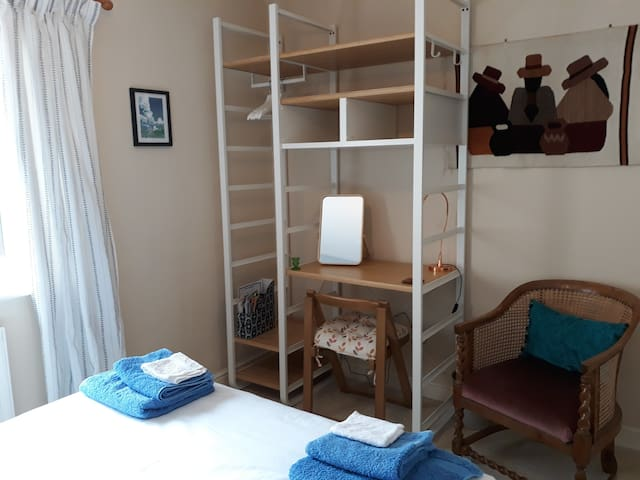 Bedroom storage with desk and seating.