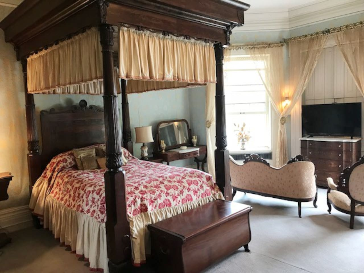 A view of the spacious living area of Alice's Room, with over 400 square feet including the private bath.