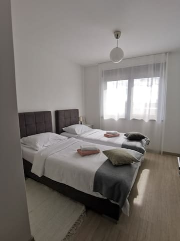 Twin beds that can be converted into a double bed if needed.