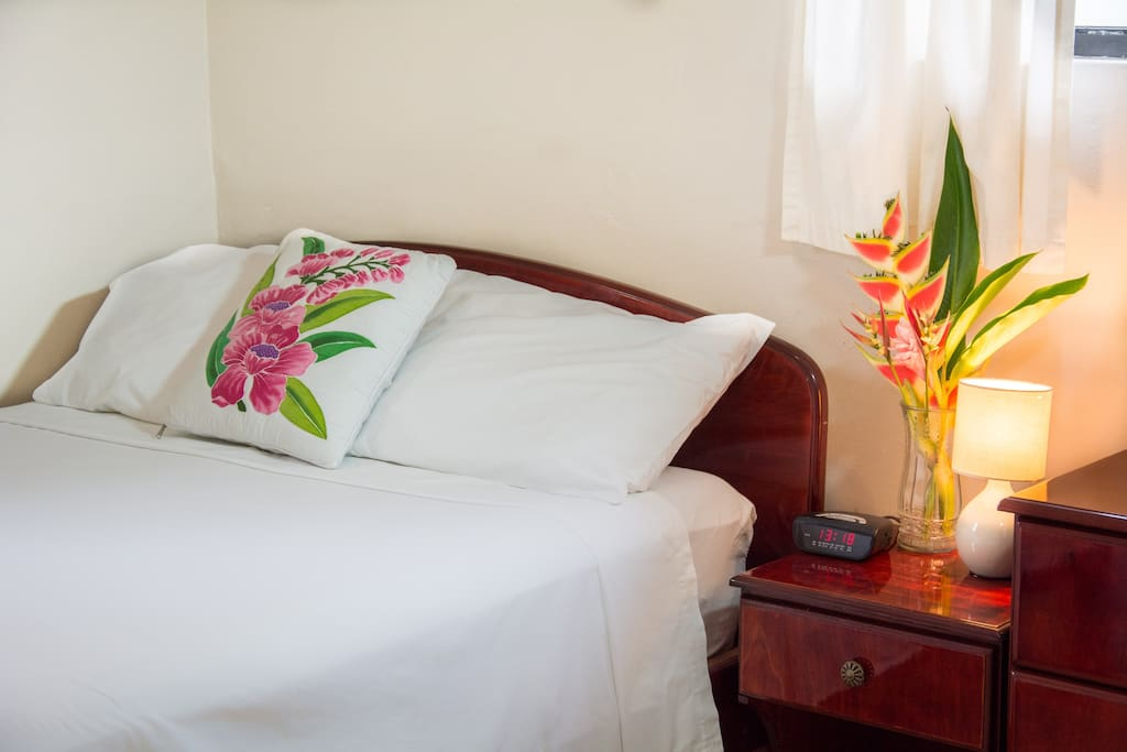 Bedroom one of Morne Seaview Apt #1. Comfortable, clean and convenient room