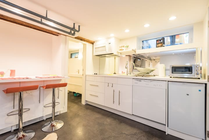 Full kitchenette with microwave, dishwasher, stove top and toaster oven