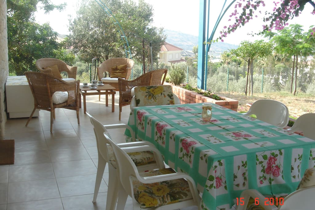 Large outdoor dining and sitting areas are very important in the climate of Cyprus.