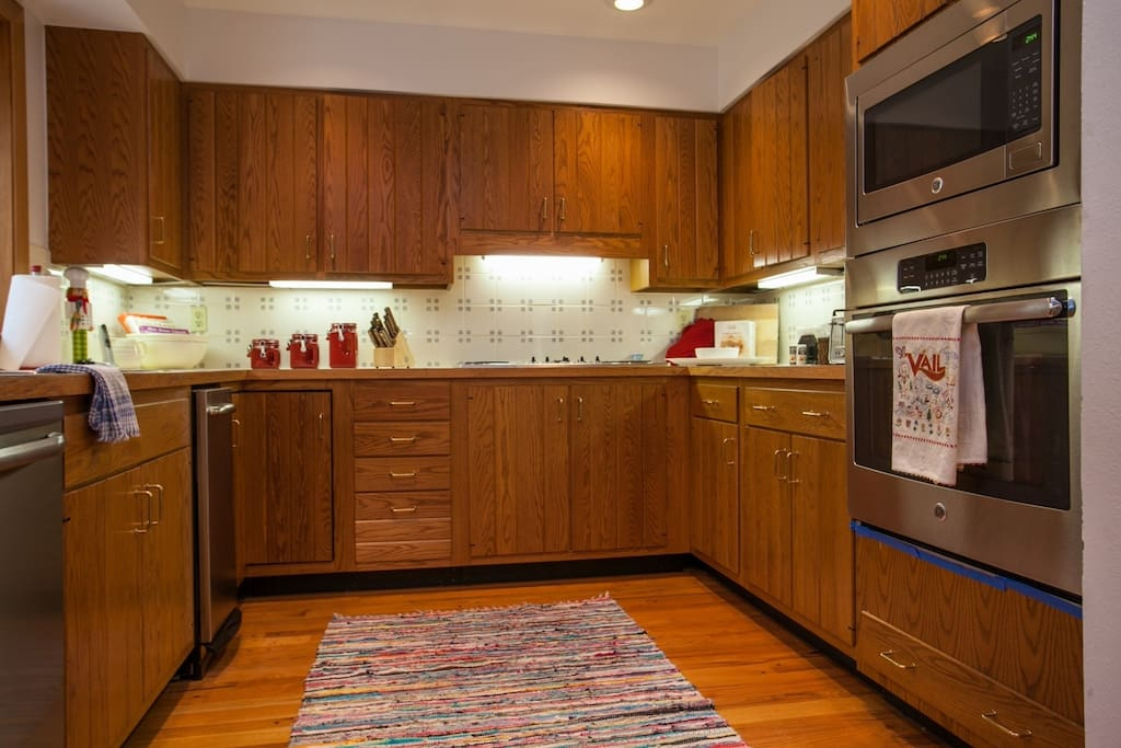 Fully equipped spacious kitchen with stainless appliances.