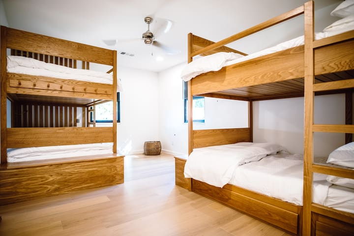 Fully Custom Double Bed Bunks with plenty of head room for adults, storage benches and under bed drawers.