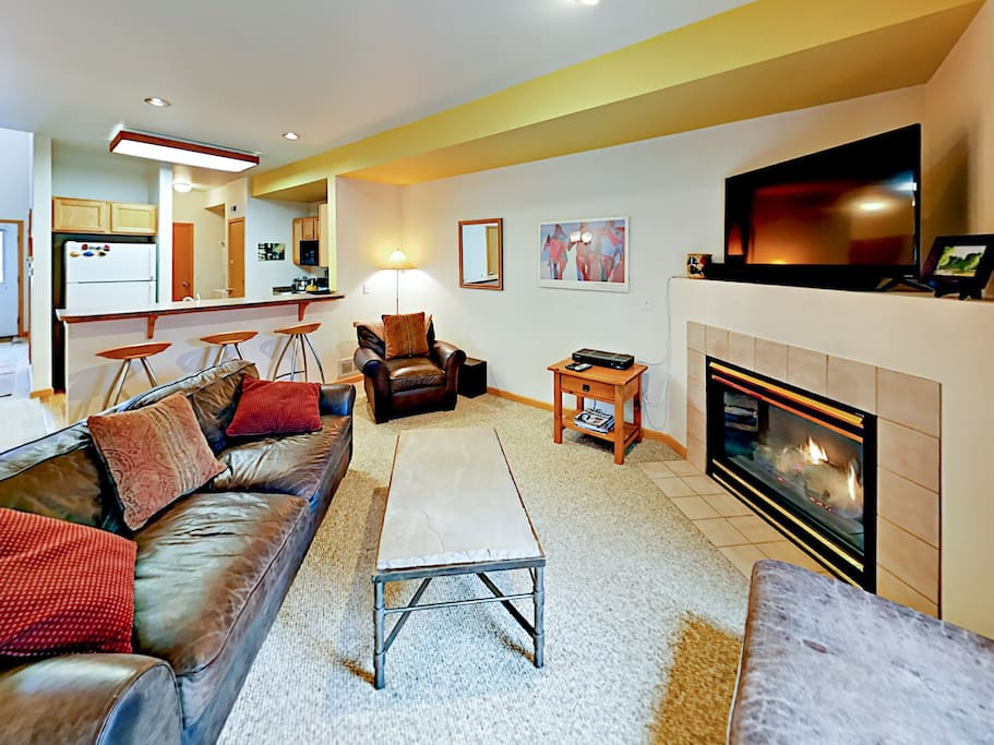 Kick back on a comfy sofa and armchair for a movie screening on the flat screen TV.
