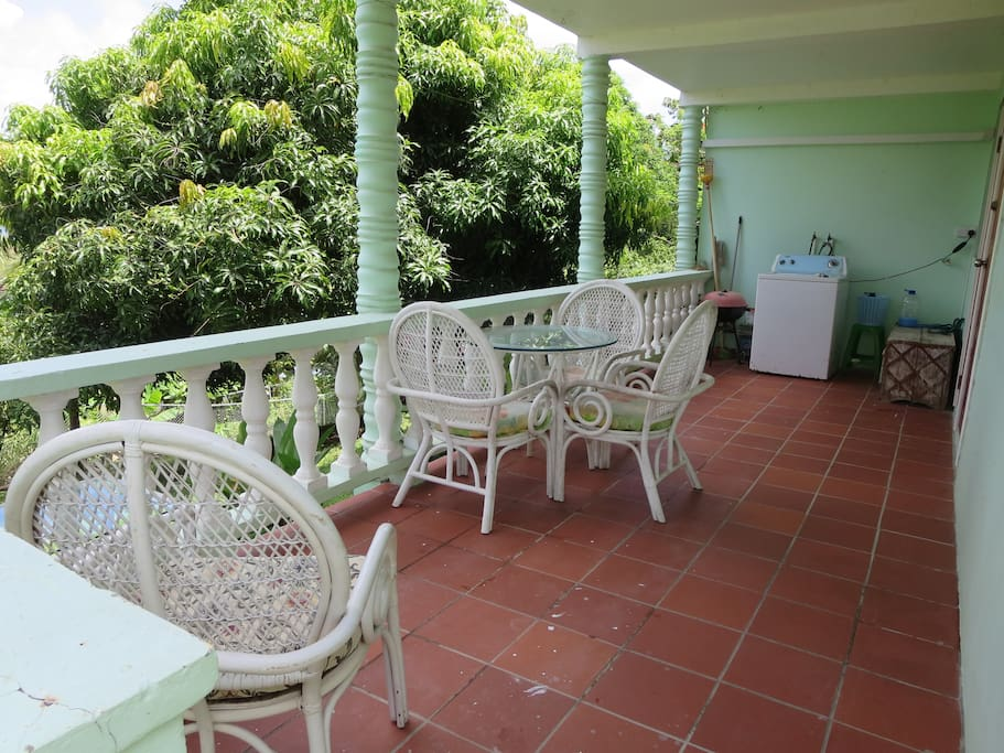 Very large balcony overlooking the garden/yard with some view of the Caribbean sea.