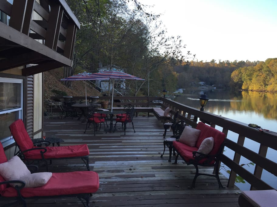 Large deck is ideal for playing family games while cooking out and fishing directly from the deck! Enjoy friendly visits from the ducks on the river- they will always enjoy any snacks you have to offer:)