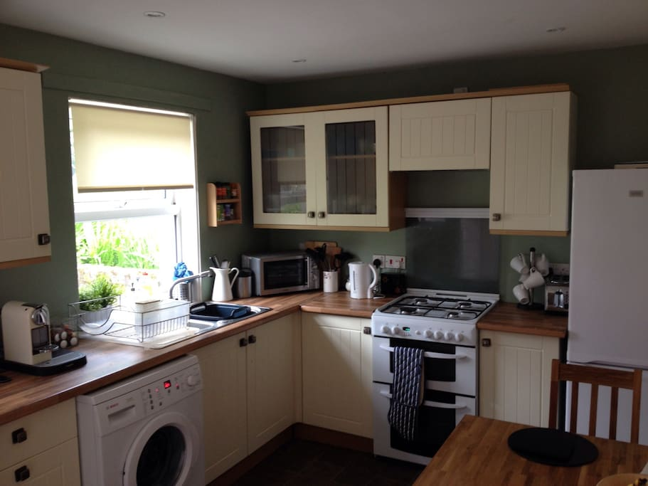 The fully fitted kitchen has microwave, gas fired oven and hob as well as washing machine and fridge freezer.