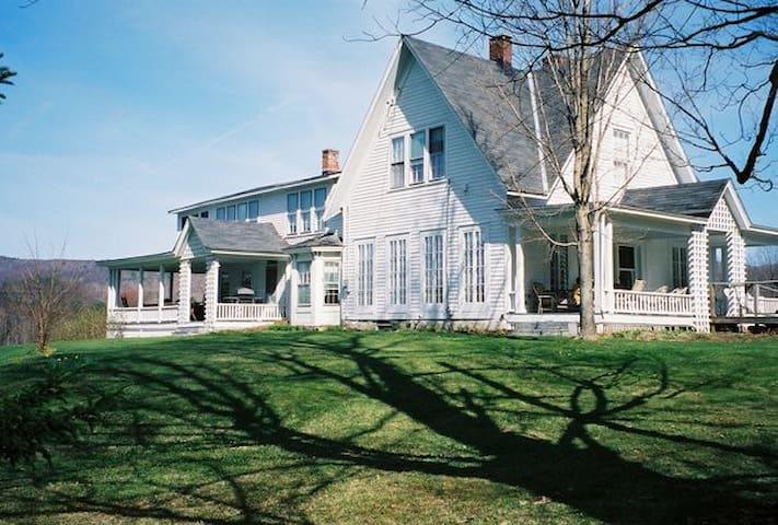 Large farmhouse with mountain views