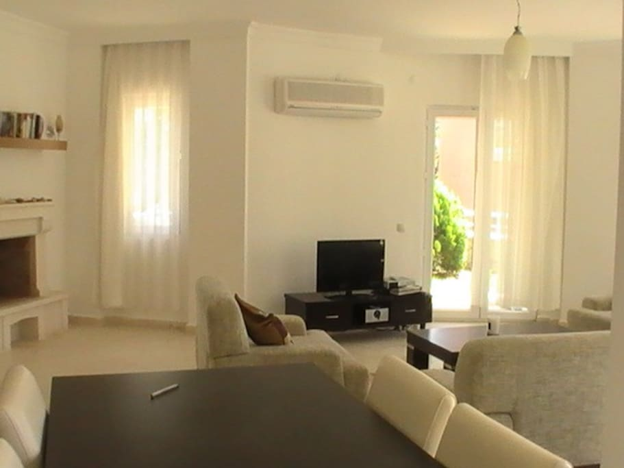 Large open plan living area with aircon, french windows onto pool area and gardens. wifi, digital tv and dvd