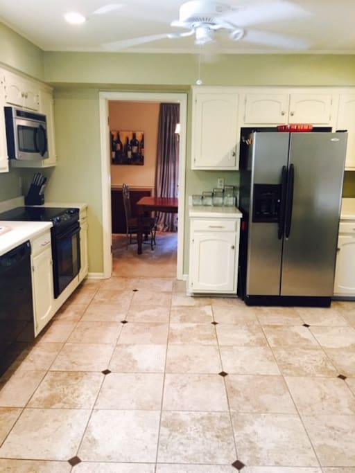 Great kitchen with access to dining room next door, and a two stool pub table in kitchen (unable to see in picture)