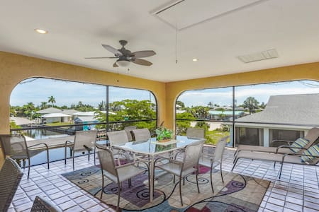 Spacious duplex-style condo w/enclosed patio & water views
