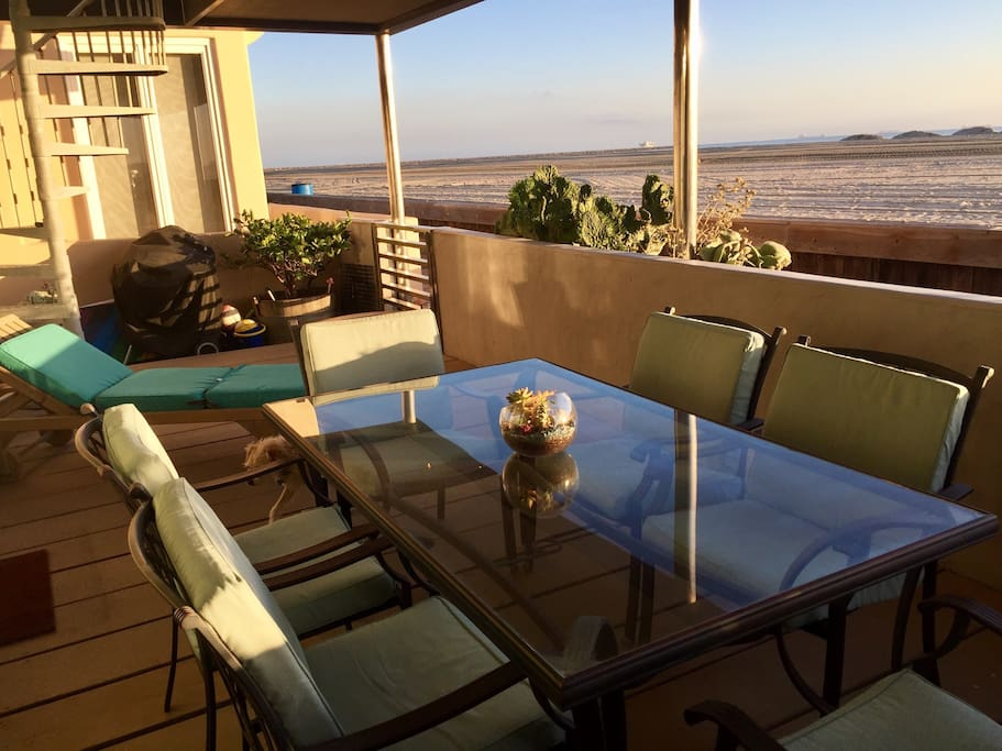 Large covered outdoor deck facing the beach, table with 6 chairs, 1 lounge chair. Charcoal Webber grill, volleyballs, beach chairs, & beach toys provided.