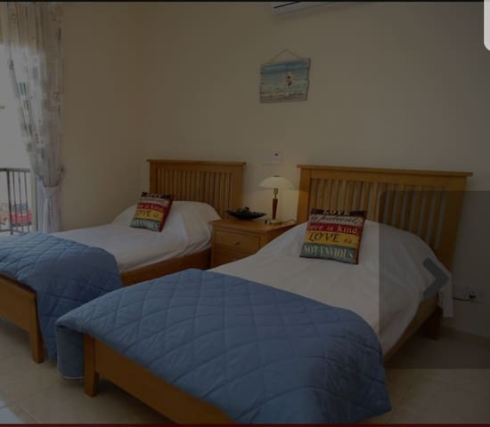 here is our other bedroom with 2 single beds, wardrobes, dressing table, bedside table and lamp.