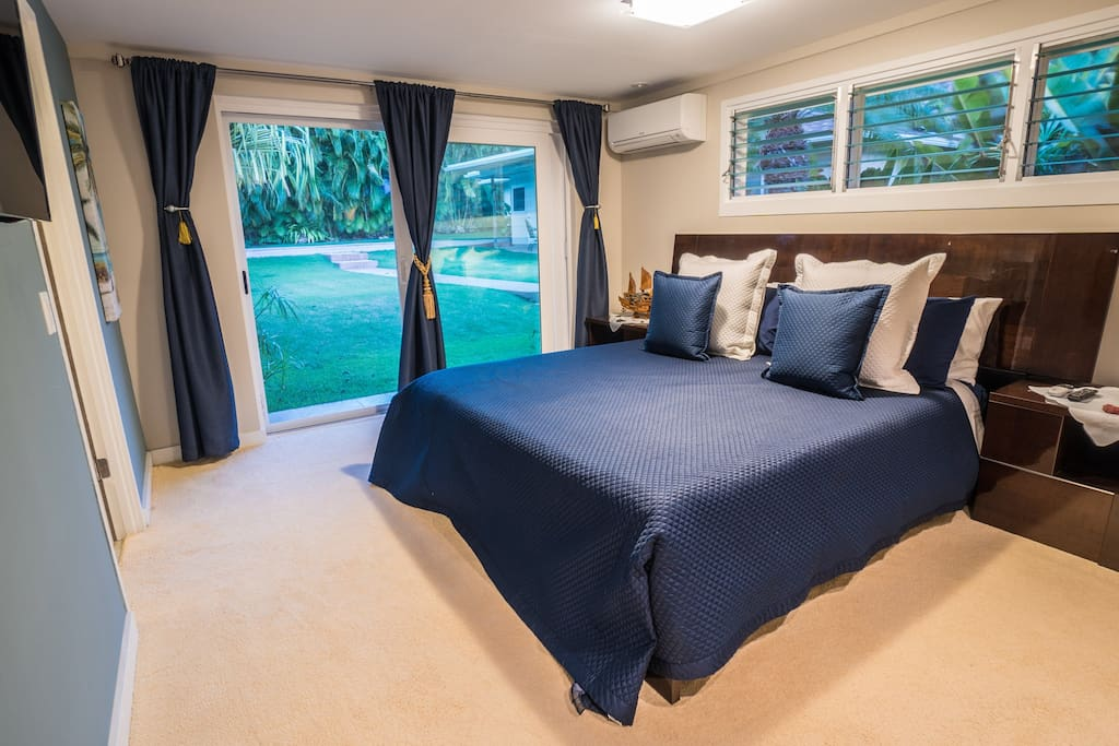 The Master Bedroom has its own TV and cable, a/c unit, a separate entrance to the backyard, and lots of natural light and breezes