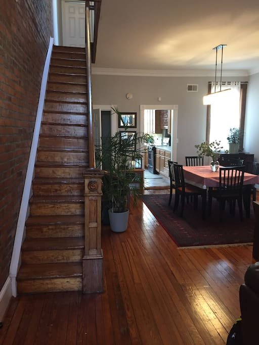 Main level - Exposed brick wall and original woodwork create wonderful ambiance.