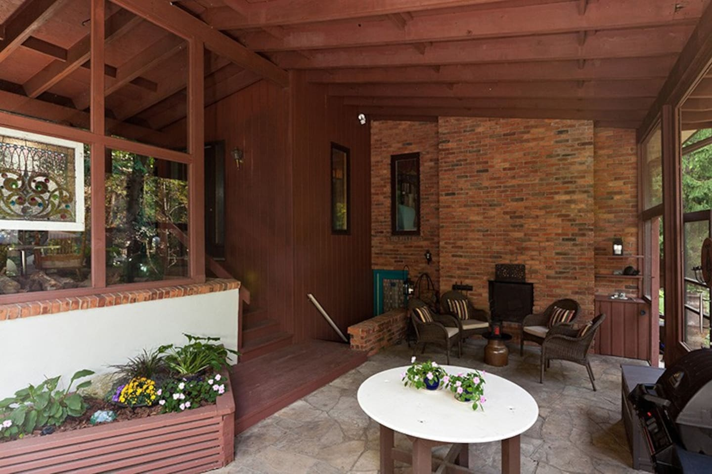 One of the things you're really going to love about staying here is how peaceful and rejuvenating our environment is and how much you'll relax.  Covered terrace, outdoor fireplace, BBQ.  It's an absolutely lovely spot to get out from under the hot sun or to enjoy a rain shower.