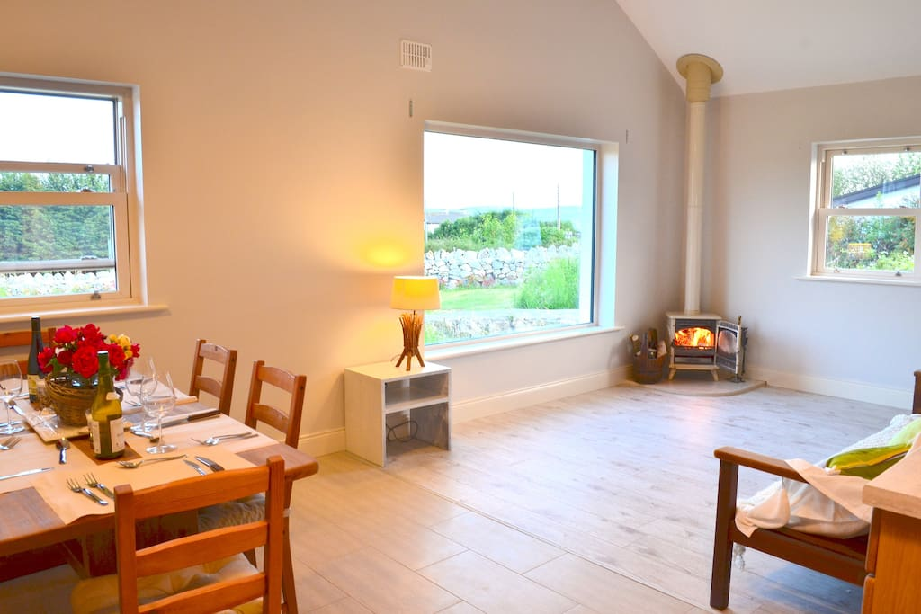 Triple glazed picture window, with stunning views.  Turf & log burning stove makes the whole room cosy & beautiful.  Enjoy a glass of wine around the fire while looking out to Galway Bay!