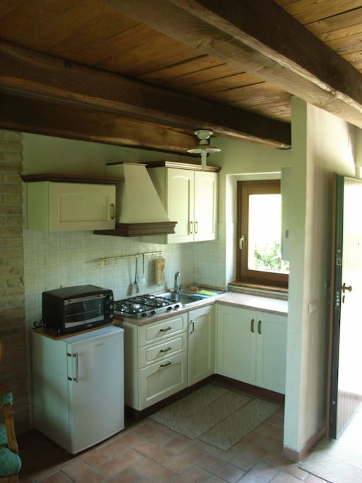 Furnished kitchen with refrigerator and oven