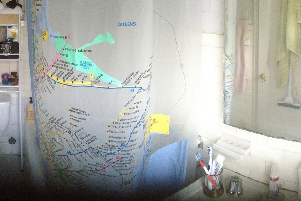 I took this as a Panorama picture with my IPhone. It's a small bathroom with a bathtub, sink and toilet.